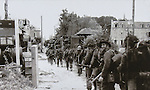 "VMI Vincentian Heritage Tour: Normandy France side trip - The 8th Canadian Brigade making their way down the ""Rue de la Mer"" near the Juno Landing site in Normandy. . (DePaul University/Jamie Moncrief)"