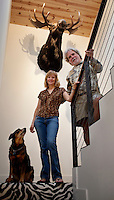 Los Angeles, California, November 14, 2009 - Portrait of Diane and Ernie Wolfe along with their dog Malaika in the stairwell of their home. Behind them is a moose Ernie shot earlier this year during a hunting trip to Alaska. The Wolfe's own the Ernie Wolfe Gallery and are the most reknowned African at dealers in the country. ..CREDIT: Daryl Peveto/LUCEO for The Wall Street Journal.Homefront - Ernie Wolfe #1348.