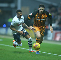 Hull City's Tommy Elphick shields the ball from Preston North End's Lukas Nmecha<br /> <br /> Photographer Stephen White/CameraSport<br /> <br /> The EFL Sky Bet Championship - Preston North End v Hull City - Wednesday 26th December 2018 - Deepdale Stadium - Preston<br /> <br /> World Copyright &copy; 2018 CameraSport. All rights reserved. 43 Linden Ave. Countesthorpe. Leicester. England. LE8 5PG - Tel: +44 (0) 116 277 4147 - admin@camerasport.com - www.camerasport.com