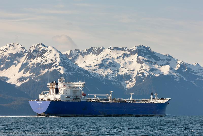 The polar enterprise oil tanker travels north into the valdez arm, Chugach mountains range borders the channel, Prince William Sound, Alaska.