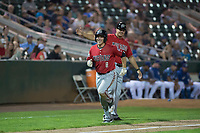 Billings Mustangs center fielder Drew Mount (8) is congratulated by third base coach Bryan LaHair (29) after hitting a home run during a Pioneer League game against the Ogden Raptors at Lindquist Field on August 17, 2018 in Ogden, Utah. The Billings Mustangs defeated the Ogden Raptors by a score of 6-3. (Zachary Lucy/Four Seam Images)