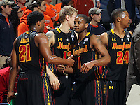 Jan. 27, 2011; Charlottesville, VA, USA; Maryland Terrapins players congratulate each other after the 66-42 win over the Virginia Cavaliers  at the John Paul Jones Arena.  Mandatory Credit: Andrew Shurtleff