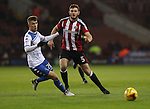 Scott Burgess of Bury tussles with Jack O'Connell of Sheffield Unitedduring the English Football League One match at Bramall Lane, Sheffield. Picture date: November 22nd, 2016. Pic Jamie Tyerman/Sportimage