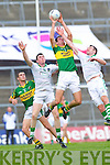 Anthony Maher beats John Cooke and Jim O'Donovan to the high ball in the Muster Senior Semi final held in The Gaelic Grounds last Saturday evening..