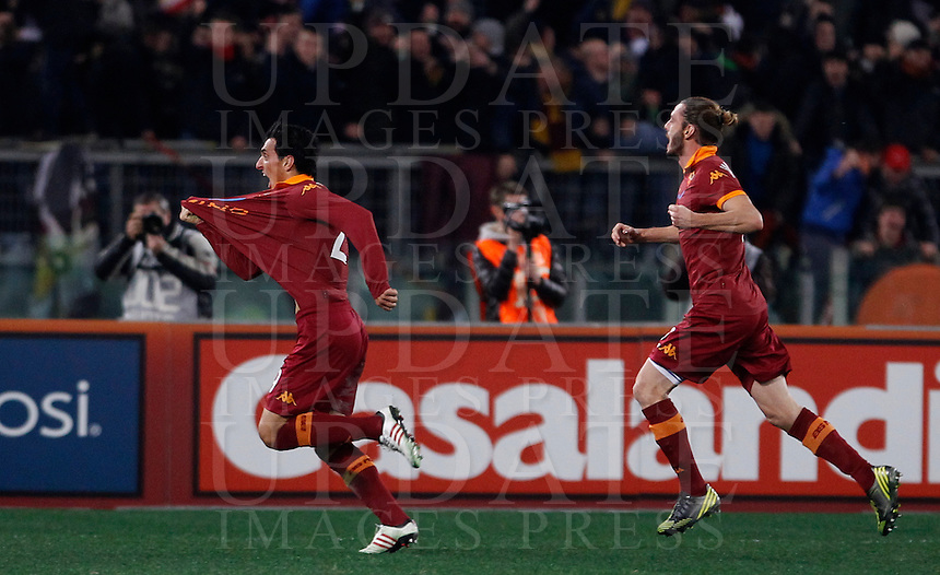 Calcio, Serie A: Roma vs Milan. Roma, stadio Olimpico, 22 dicembre 2012..AS Roma defender Nicolas Burdisso, of Argentina, celebrates with teammate Federico Balzaretti, right, after scoring during the Italian Serie A football match between AS Roma and AC Milan at Rome's Olympic stadium, 22 December 2012..UPDATE IMAGES PRESS/Isabella Bonotto