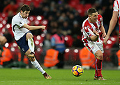 9th December 2017, Wembley Stadium, London England; EPL Premier League football, Tottenham Hotspur versus Stoke City; Ben Davies of Tottenham Hotspur shot is blocks by Kevin Wimmer of Stoke City