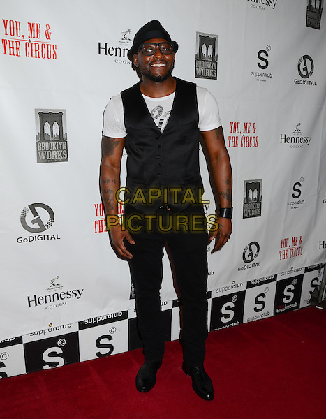 "Omar Epps.Arrivals for the movie premiere of ""You, Me & The Circus"" held at The Supper Club, Hollywood, California, USA..August 28th, 2012.full length jeans denim black hat waistcoat glasses white t-shirt .CAP/ADM/BT.©Birdie Thompson/AdMedia/Capital Pictures."