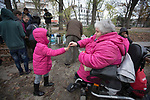 A volunteer from the We Picknick group giving a sweet to a refugee child in Berlin. The volunteer initiative was one of many initiated by citizens of the city to help refugees. Around 60,000 refugees arrived in the city in the first 10 months of 2015, out of an overall total of around 850,000 in the whole of Germany.