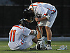 Zach Amelia #11, left, and Jason Carlock #14 of Babylon commiserate after their team's 11-10 overtime loss to Westlake in the NYSPHSAA varsity boys lacrosse Class D state semifinals at Adelphi University in Garden City, NY on Wednesday, June 7, 2017. Up 10-7 late in the fourth quarter, Babylon surrendered three goals in the final three mintues of regulation before falling in overtime.