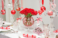The dining table is decorated in a red and white festive theme in celebration of Christmas