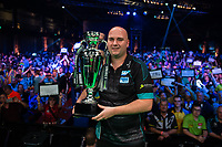 27th October 2019, Gottingen, Lower Saxony, Germany:  PDC European Championships; Final round; Rob Cross from England with the trophy after winning the final against Price.