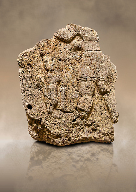 Photo of Hittite relief sculpted orthostat stone panel of Long Wall Limestone, Karkamıs, (Kargamıs), Carchemish (Karkemish), 900 - 700 B.C. Anatolian Civilizations Museum, Ankara, Turkey. The short-skirted figure with a dagger at the waist holds the gazelle from its hind legs.<br /> <br /> On a brown art background.