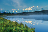 Sunrise Light On Mt. Denali With The Mist Rising From Wonder Lake, Denali National Park, Alaska