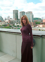 French actress Emanuelle Bear  who is the President of the 25th  World Film Festival's  Jury pose  in front of Montreal's skyline,  at  a reception at Montreal City Hall, august 29th , 200l in Montreal, CANADA.<br /> <br /> Brought up on a farm in Provence because her father, French singer and poet Guy B&Egrave;art didn't want her to be affected by the glamour world of Paris showbusiness, Emmanuelle B&Egrave;art nevertheless got the acting urge in early adolescence. At age 15, after a couple of bit parts, she came to Montreal as an au pair to learn English. Back in France, after acting lessons and few small roles in television, she made her big-screen breakthrough in the title role of Claude Berri's Pagnol adaptation, MANON OF THE SPRING (1986). A year later she made her Hollywood debut in Tom McLoughlin's DATE WITH AN ANGEL. She has since played for some of the premier directors on both sides of the Atlantic: Rivette (LA BELLE NOISEUSE, 1991), Sautet (NELLY AND MR. ARNAUD (1995), Chabrol (L'ENFER,1994), De Palma (MISSION: IMPOSSIBLE, 1996) and Ruiz (TIME REGAINED, 1999). She stars in Catherine Corsini's REPLAY, showing at this year's Festival.<br /> <br /> <br /> Photo by John Raudsepp / Getty Images<br /> (ON SPEC- Scanned &amp; Transmitted  by &amp; Payable to<br /> Pierre Roussel)<br /> <br /> NOTE : 35mm film scan