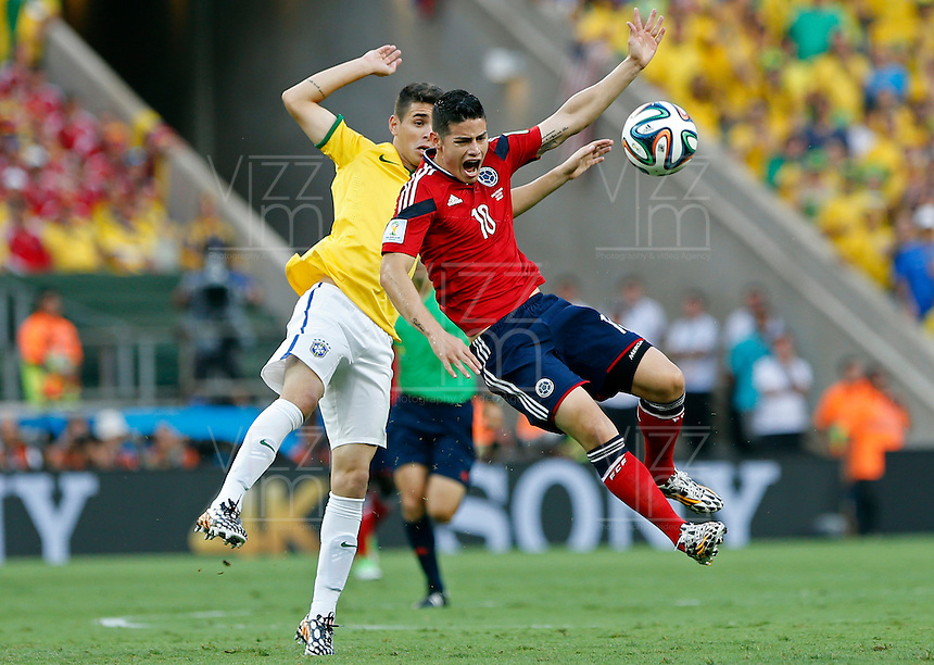 FORTALEZA - BRASIL -04-07-2014. Foto: Daniel Jayo / Archivolatino<br /> James Rodriguez (#10) jugador de Colombia (COL) disputa un balón con Oscar (#11) jugador de Brasil (BRA) durante partido de los cuartos de final por la Copa Mundial de la FIFA Brasil 2014 jugado en el estadio Castelao de Fortaleza./ James Rodriguez (#10) player of Colombia (COL) fights the ball with Oscar (#11) player of Brazil (BRA) during the match of the Quarter Finals for the 2014 FIFA World Cup Brazil played at Castelao stadium in Fortaleza. Daniel Jayo / Archivolatino<br /> VizzorImage PROVIDES THE ACCESS TO THIS PHOTOGRAPH ONLY AS A PRESS AND EDITORIAL SERVICE IN COLOMBIA AND NOT IS THE OWNER OF COPYRIGHT; ANOTHER USE IS REPONSABILITY OF THE END USER. NO SALES, NO MERCHANDASING. ALL COPYRIGHT IS ARCHIVOLATINO