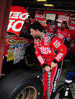 May 1, 2009; Richmond, VA, USA; NASCAR Sprint Cup Series driver Tony Stewart jacks up his car i the garage during practice for the Russ Friedman 400 at the Richmond International Raceway. Mandatory Credit: Mark J. Rebilas-