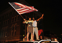 Washingtonians celebrate with the Stars and Stripes flag moments after it was announced that Barack Obama had won the presidential election.