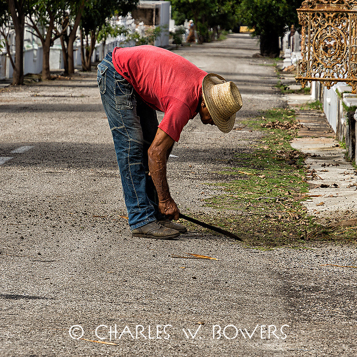 Faces Of Cuba - Mowing grass the hard way!<br />