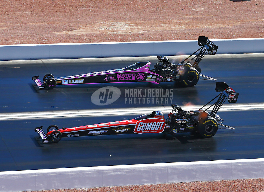Nov 2, 2014; Las Vegas, NV, USA; NHRA top fuel driver Leah Pritchett (near) defeats Antron Brown during the Toyota Nationals at The Strip at Las Vegas Motor Speedway. Mandatory Credit: Mark J. Rebilas-USA TODAY Sports