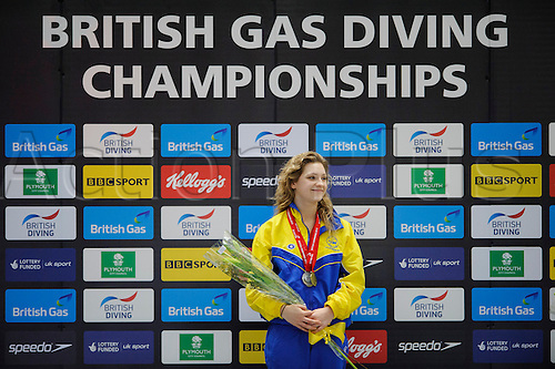 08.02.2013 Plymouth, England. Alicia Blagg (City of Leeds Diving Club) smiles on the podium with her medal after winning Womens 1m Springboard Final on Day 1 of the British Gas Diving Championships 2013 at Plymouth Life Centre.