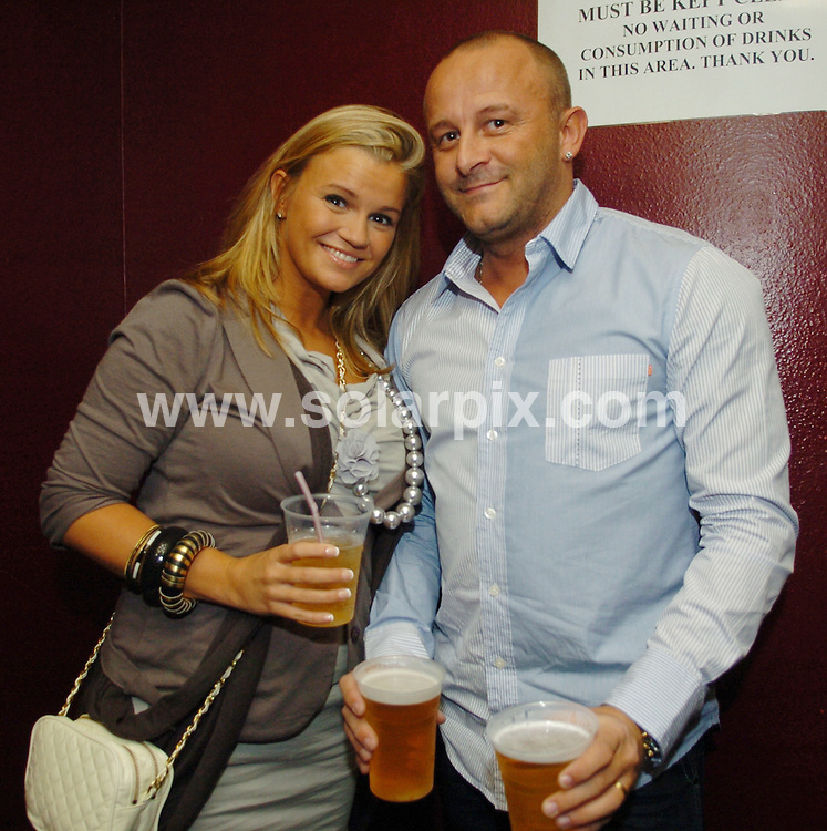 **ALL ROUND PICTURES FROM SOLARPIX.COM**.**WORLDWIDE SYNDICATION RIGHTS**.The Nolans perform at Manchester Apollo, Manchester, UK. 13 October 2009..This pic: Kerry Katona and Mark Croft..JOB REF: 10112 SGD     DATE: 13_10_2009.**MUST CREDIT SOLARPIX.COM OR DOUBLE FEE WILL BE CHARGED**.**MUST NOTIFY SOLARPIX OF ONLINE USAGE**.**CALL US ON: +34 952 811 768 or LOW RATE FROM UK 0844 617 7637**