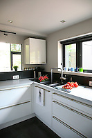 """The kitchen was designed in """"laboratory"""" style to be as functional and space-saving as possible"""