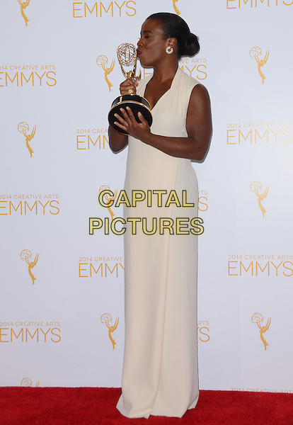 16 August 2014 - Los Angeles, California - Uzo Aduba. Winners of the 2014 Creative Arts Emmy Awards press room held at Nokia Theater L.A. LIVE in Los Angeles, Ca.  <br /> CAP/ADM/BT<br /> &copy;Birdie Thompson/AdMedia/Capital Pictures