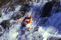 Waterfall massage at Silver Falls ranch, Kauai north shore. Model release. Destination for commercial horse trail rides.