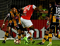 BOGOTA - COLOMBIA - 23 - 05 - 2017: Damir Ceter (Der.) jugador de Independiente Santa Fe, disputa el balón con Diego Wayar (Izq.) jugador de The Strongest, durante partido entre Independiente Santa Fe de Colombia y The Strongest de Bolivia, de la fase de grupos, grupo 2, fecha 6 por la Copa Conmebol Libertadores Bridgestone 2017, en el estadio Nemesio Camacho El Campin, de la ciudad de Bogota. / Damir Ceter (R) player of Independiente Santa Fe, fights for the ball with Diego Wayar (L) player of The Strongest during a match between Independiente Santa Fe of Colombia and The Strongest of Bolivia, of the group stage, group 2 of the date 6th, for the Conmebol Copa Libertadores Bridgestone 2017 at the Nemesio Camacho El Campin in Bogota city. VizzorImage / Luis Ramirez / Staff.