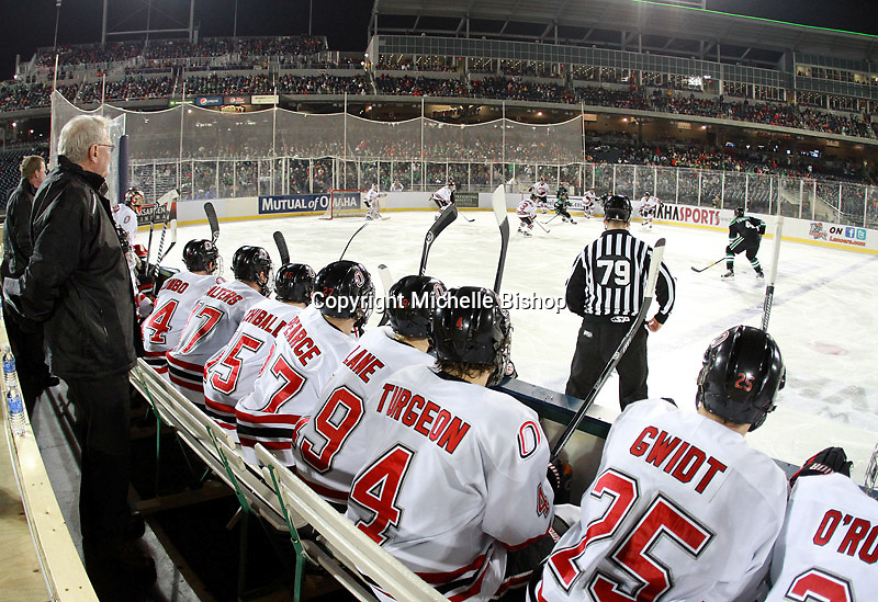 The view from the Nebraska-Omaha bench during the first period. North Dakota beat Nebraska-Omaha 5-2 in the outdoor game at TD Ameritrade Park on Saturday, Feb. 9, 2013. (Photo by Michelle Bishop)