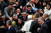 Pope Francis greets the faithful at the end of his weekly general audience in the Paul VI hall at the Vatican, January 22, 2020.<br />