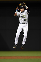 Shortstop Edgardo Fermin (10) of the Columbia Fireflies grabs a pop fly to begin an inning-ending double play in a game against the Augusta GreenJackets on Opening Day, Thursday, April 5, 2018, at Spirit Communications Park in Columbia, South Carolina. Columbia won, 4-2. (Tom Priddy/Four Seam Images)