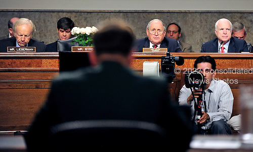 Reverse view of General David H. Petraeus, U.S. Army, testimony before the United States Senate Armed Services Committee hearing on his nomination to be commander of the International Security Assistance Force and commander of the United States Forces in Afghanistan in Washington, D.C. on Tuesday, June 29, 2010.  Pictured from left: U.S. Senator Joseph Lieberman (Independent Democrat of Connecticut); the memorial to U.S. Senator Robert Byrd (Democrat of West Virginia); U.S. Senator Carl Levin (Democrat of Michigan), General Petraeus; and U.S. Senator John McCain (Republican of Arizona)..Credit: Ron Sachs / CNP