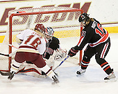 Kelli Stack (BC - 16), Leah Sulyma (NU - 1), Julia Marty (NU - 16) - The Boston College Eagles defeated the visiting Northeastern University Huskies 2-1 on Sunday, January 30, 2011, at Conte Forum in Chestnut Hill, Massachusetts.