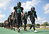 The Wyandanch varsity football team marches to its locker room before a Division IV game against Center Moriches at Wyandanch High School on Thursday, Sept. 7, 2017.