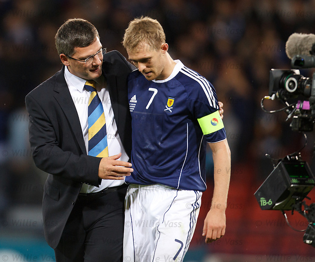 Craig Levein and Darren Fletcher embrace after the Scotland captain's 50th cap