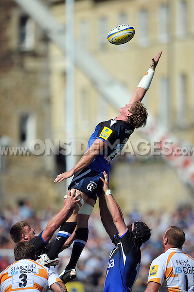 Stuart Hooper rises high to try and win the ball at a lineout. Aviva Premiership match, between Bath Rugby and London Wasps on September 8, 2012 at the Recreation Ground in Bath, England. Photo by: Patrick Khachfe / Onside Images