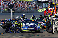 Jimmy Johnson makes a pit stop during a 2006 NASCAR race at Michigan International Speedway near Brooklyn, Michigan.