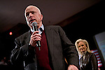 Sen. John McCain (R-AZ) speaks at a presidential campaign rally as his wife Cindy looks on in Newport, NH, on Sunday, Dec. 30, 2007.