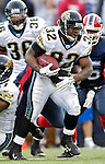 26 November 2006: Jacksonville Jaguars running back Maurice Jones-Drew (32) rushes for yardage against the Buffalo Bills at Ralph Wilson Stadium in Orchard Park, NY. The Bills defeated the Jaguars 27-24. Mandatory Photo Credit: Ed Wolfstein Photo<br />