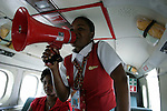 February 13, 2004. Port Au Prince. On the airplane the stewardess tells the instructions for flying to the passengers on a bullhorn.