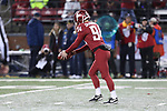 Washington State punter, Oscar Draguicevich, punts during the Cougs big home victory over the California Golden Bears.