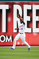 Buffalo Bisons left fielder Melky Mesa (24) catches a fly ball during a game against the Louisville Bats on June 23, 2016 at Coca-Cola Field in Buffalo, New York.  Buffalo defeated Louisville 9-6.  (Mike Janes/Four Seam Images)