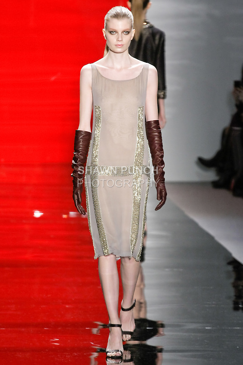 Saara walks runway in a dove silk chiffon sheath dress with beaded embroidery, from the Reem Acra Fall 2012 Feminine Power collection fashion show, during Mercedes-Benz Fashion Week New York Fall 2012 at Lincoln Center.