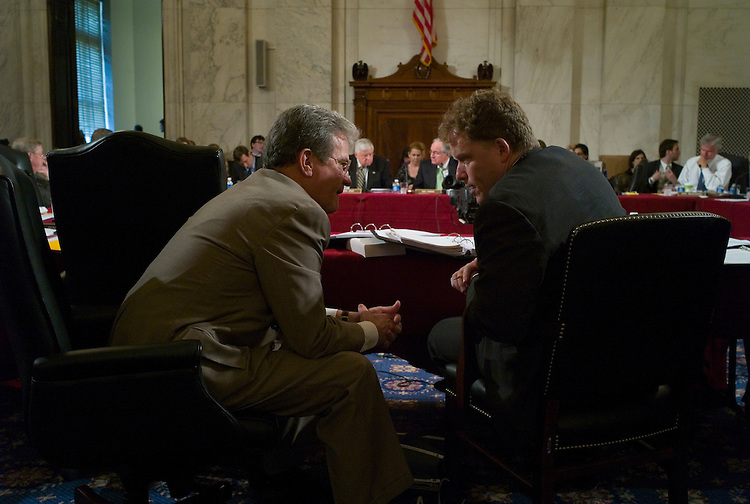 WASHINGTON, DC - July 9: Sen. Tom Coburn, R-Okla., consults with committee staff director for health care David Bowen during the Senate Health, Education, Labor and Pensions markup of a comprehensive health care overhaul bill. (Photo by Scott J. Ferrell/Congressional Quarterly)