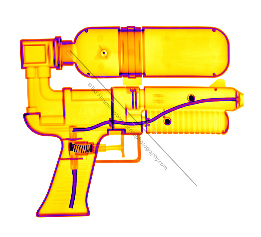 An X-ray of a squirt gun. This gun shoots water when the trigger is pulled.