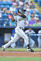 Augusta GreenJackets left fielder Jean Angomas (11) swings at a pitch during a game against the Asheville Tourists at McCormick Field on August 5, 2016 in Asheville, North Carolina. The Tourists defeated the GreenJackets 7-6. (Tony Farlow/Four Seam Images)