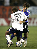 2 April 2005: Brian Mullan of Earthquakes fights for the ball against Marshall Leonard of Revolution during the second half of the game at Spartan Stadium in San Jose, California.  Earthquakes and Revolution tied 2-2.   Credit: Michael Pimentel / ISI