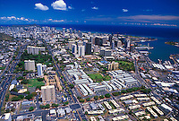 Areal view of downtown Honolulu and Honolulu Harbor with Diamond Head Crater in the distance.
