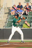 Carlos Lopez (7) of the Greensboro Grasshoppers at bat against the Kannapolis Intimidators at CMC-Northeast Stadium on June 12, 2014 in Kannapolis, North Carolina.  The Grasshoppers defeated the Intimidators 5-2.  (Brian Westerholt/Four Seam Images)